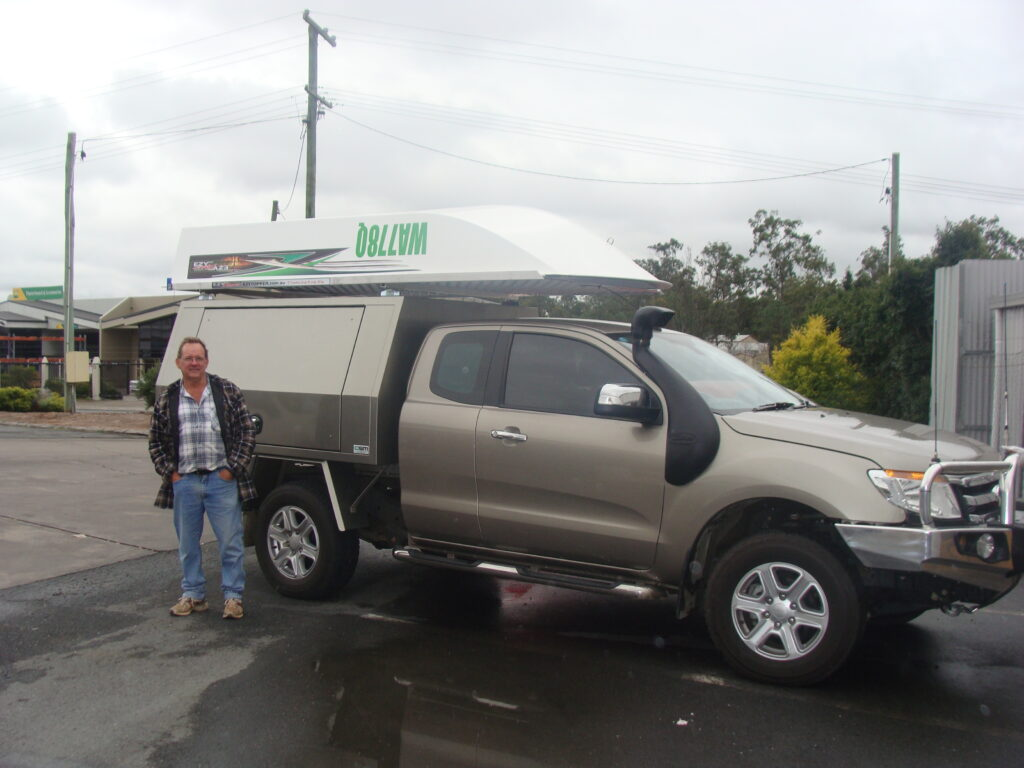 Alan Aubrey from Bald Hills Qld with his 3.7m Barra Roof top boat mounted on a Ford Ranger